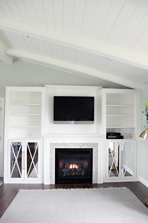 Built-in focal point with electric fireplace feature.