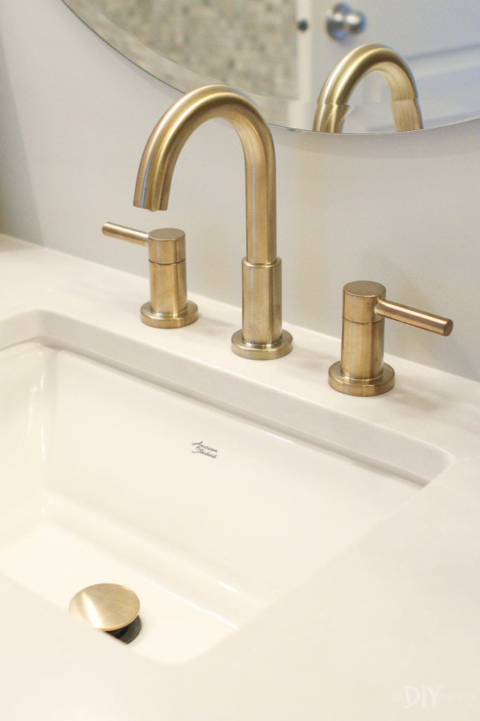american standard sink and brass faucet