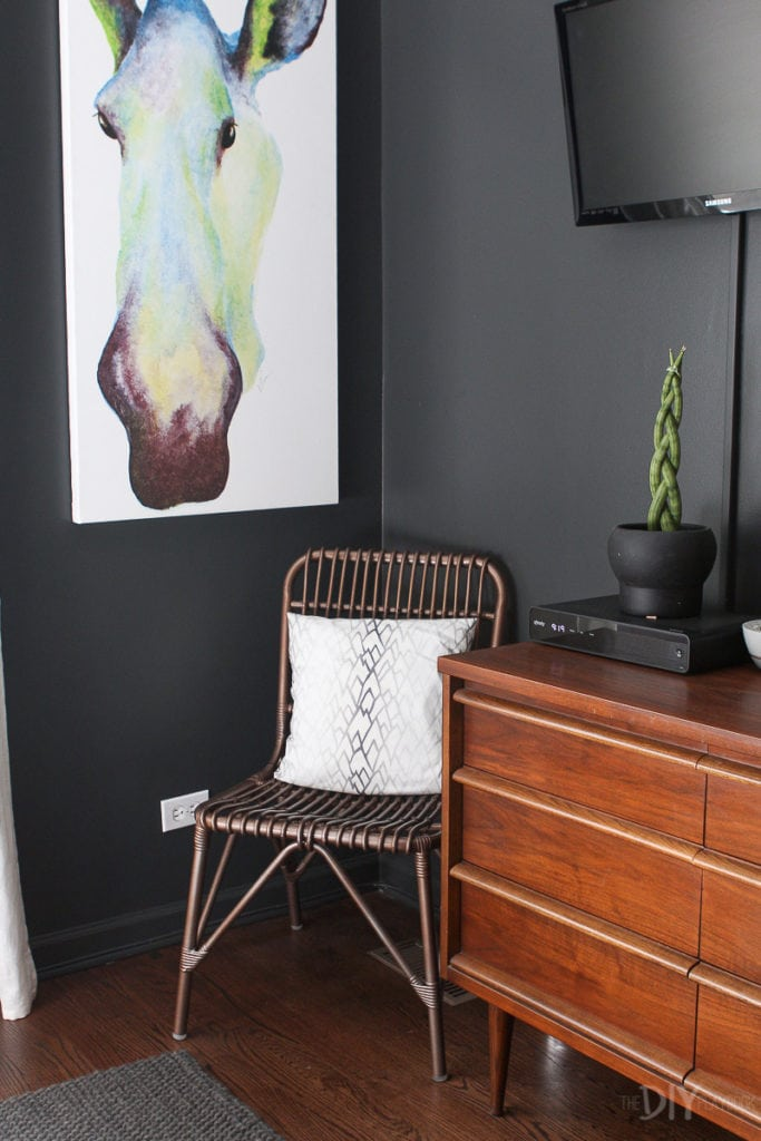 Chair and artwork in a master bedroom corner
