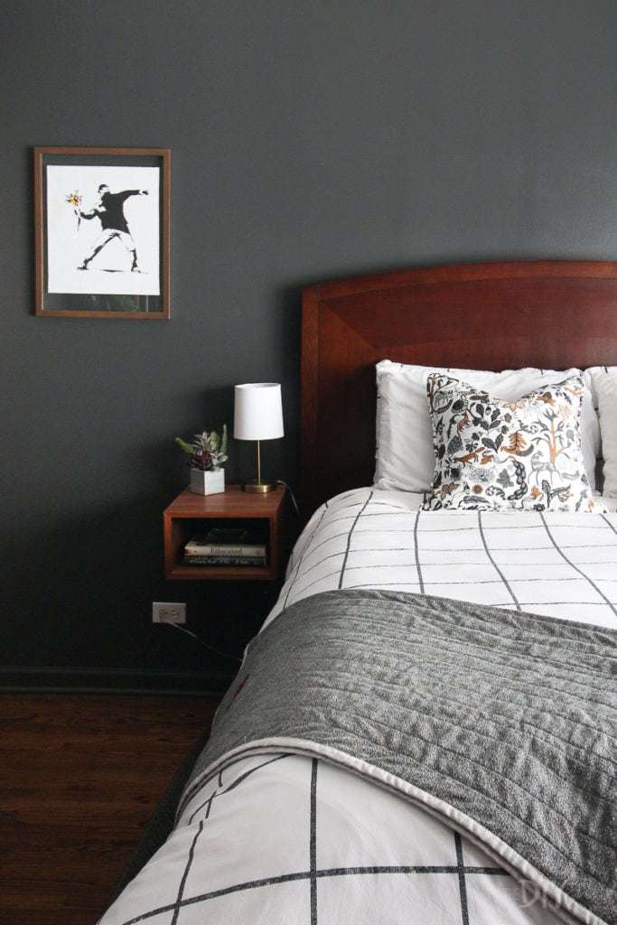 Black walls in a master bedroom