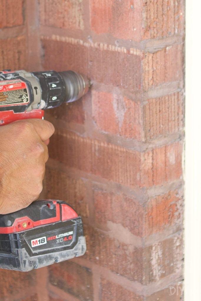 hammer drill into brick