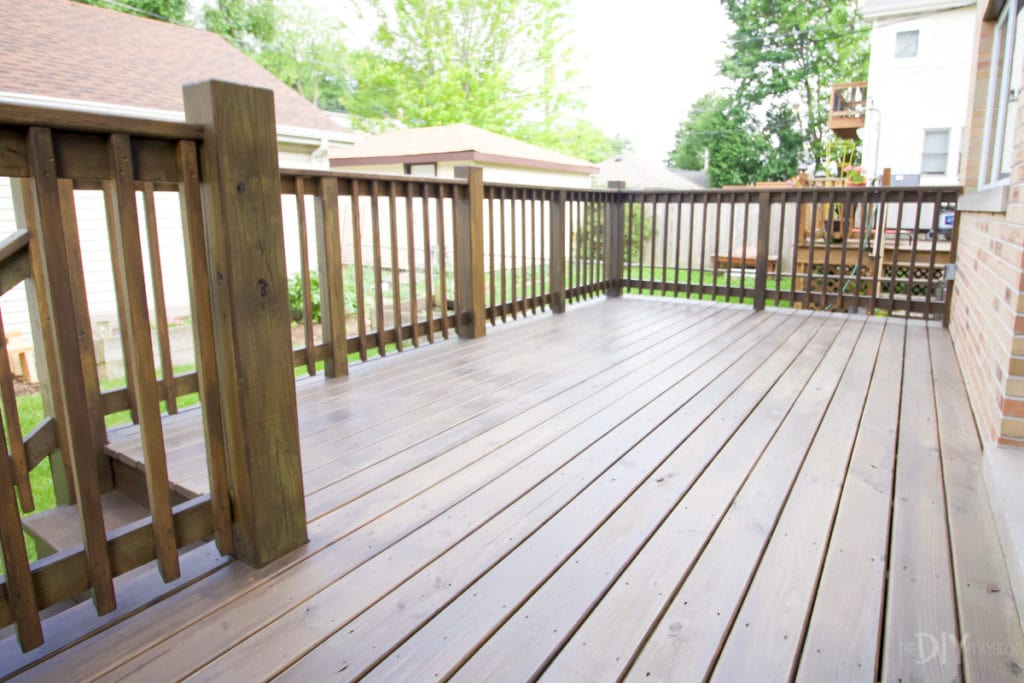 The deck after staining with a paint sprayer