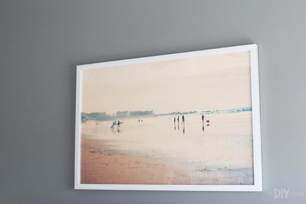 Beachy art over the bed