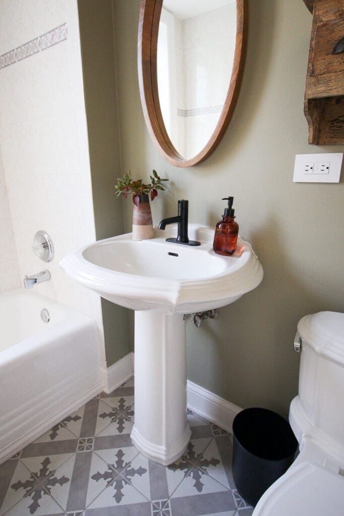 Old pedestal sink with new faucet