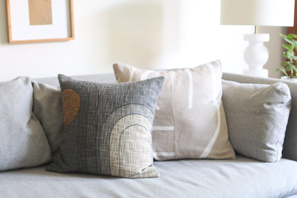 Neutral textiles on a gray couch