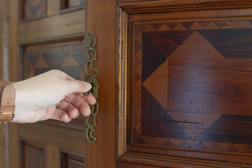 Using a key to open the antique hutch