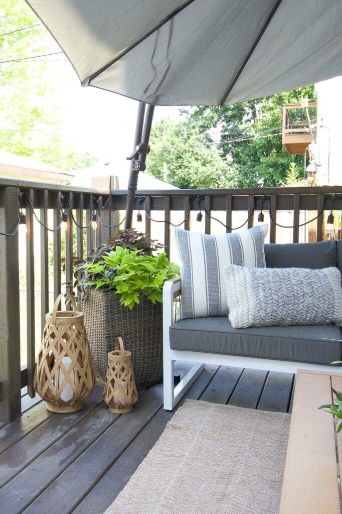 Outdoor planter and umbrella on this deck makeover