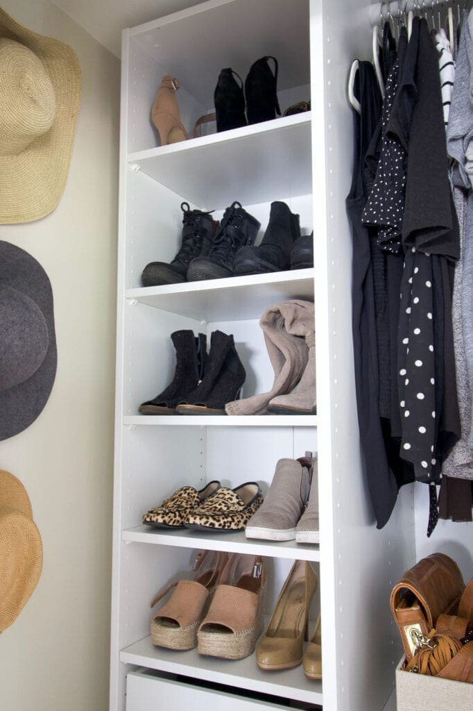 Shoes on shelves in an ikea closet