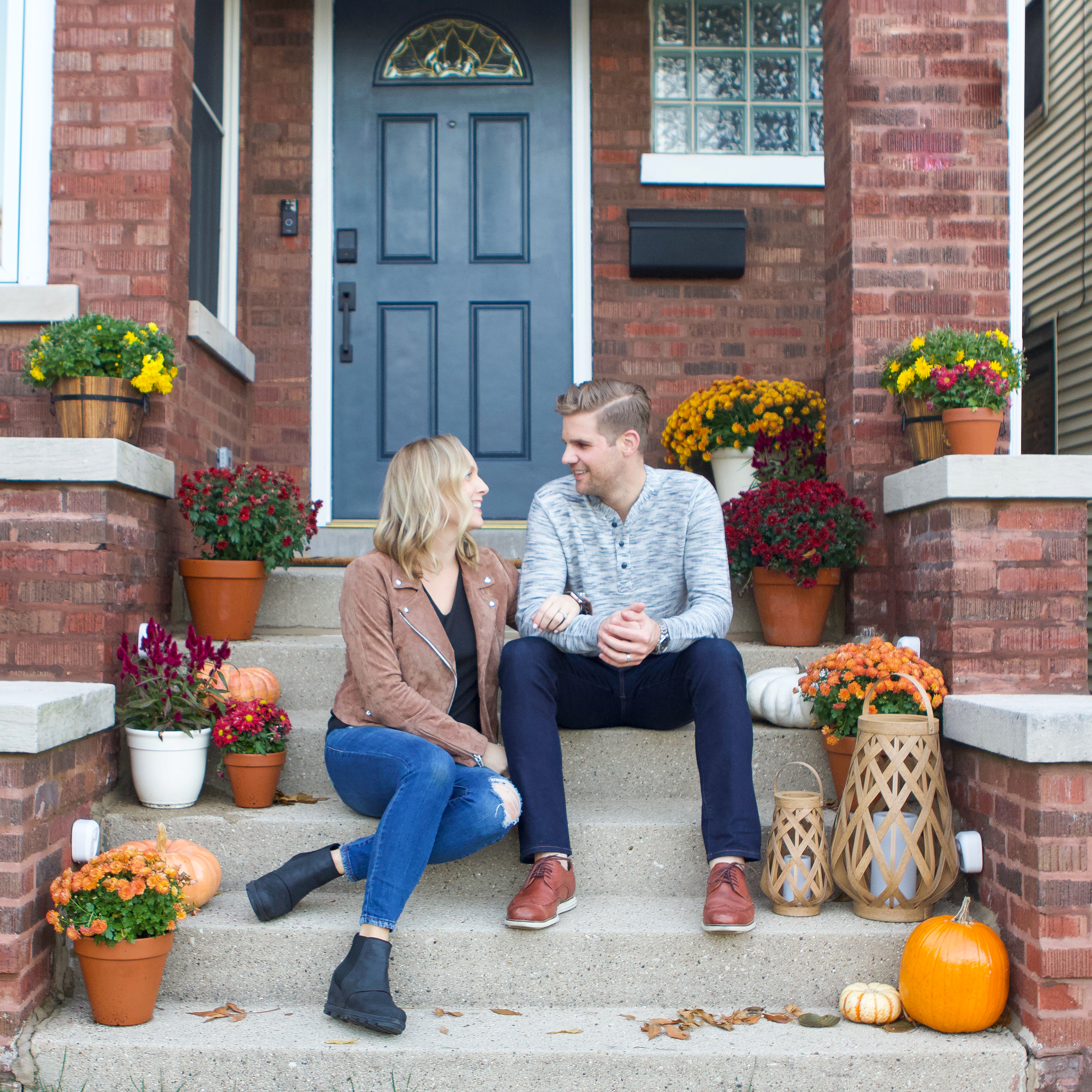 Casey and Finn on Fall front porch