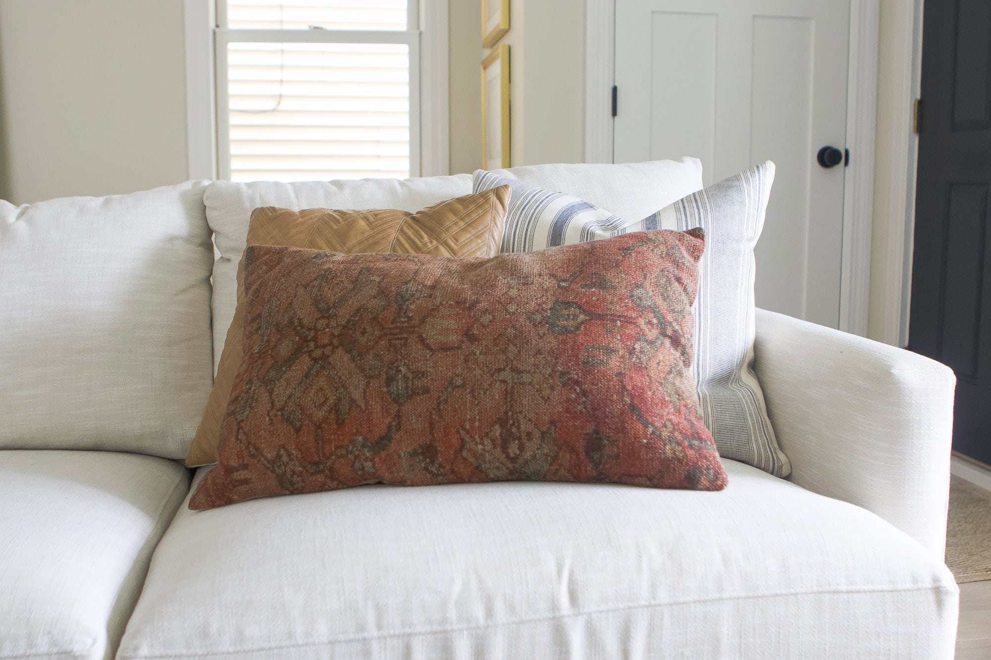 Adding colorful pillows to a neutral couch