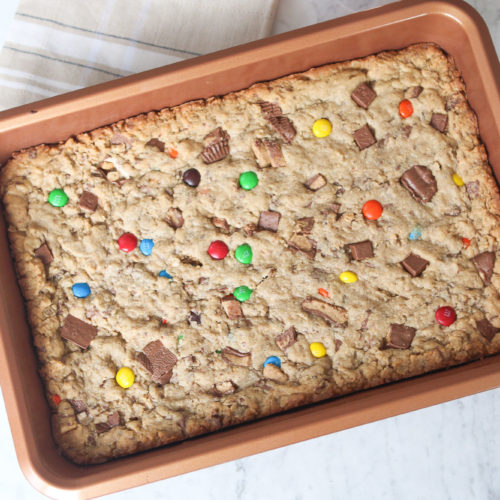 Loaded cookie bar recipe using leftover halloween candy