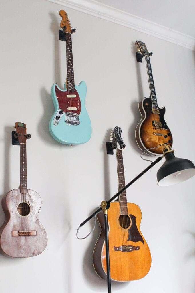 Hanging guitars on the wall