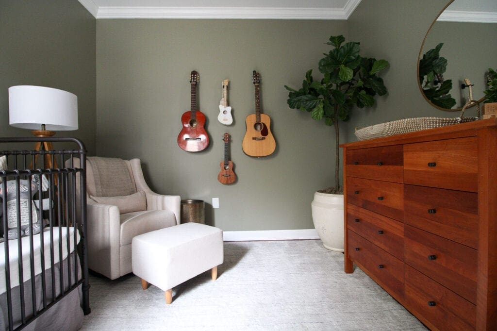 A nursery with sage green walls