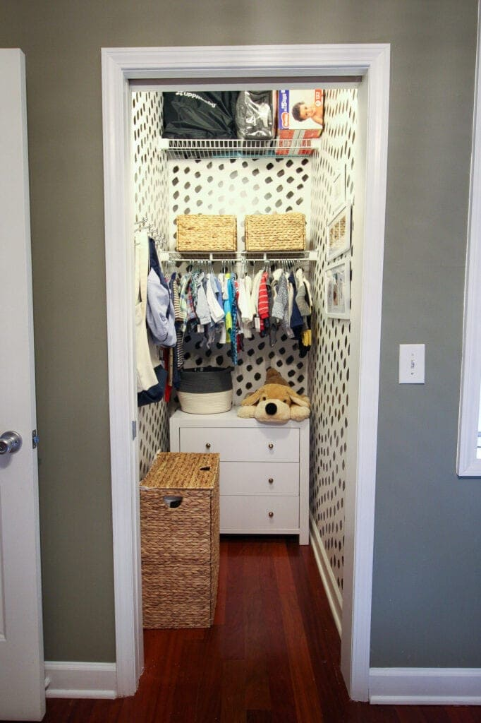 Nursery closet with painted walls