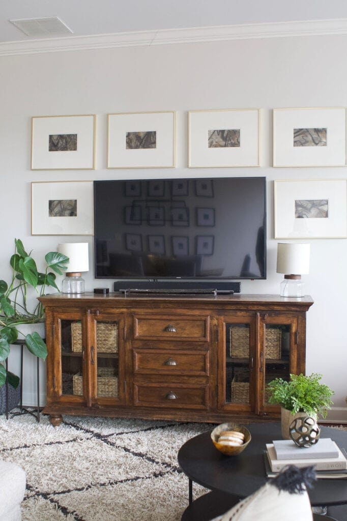 Wood TV console with frames around it