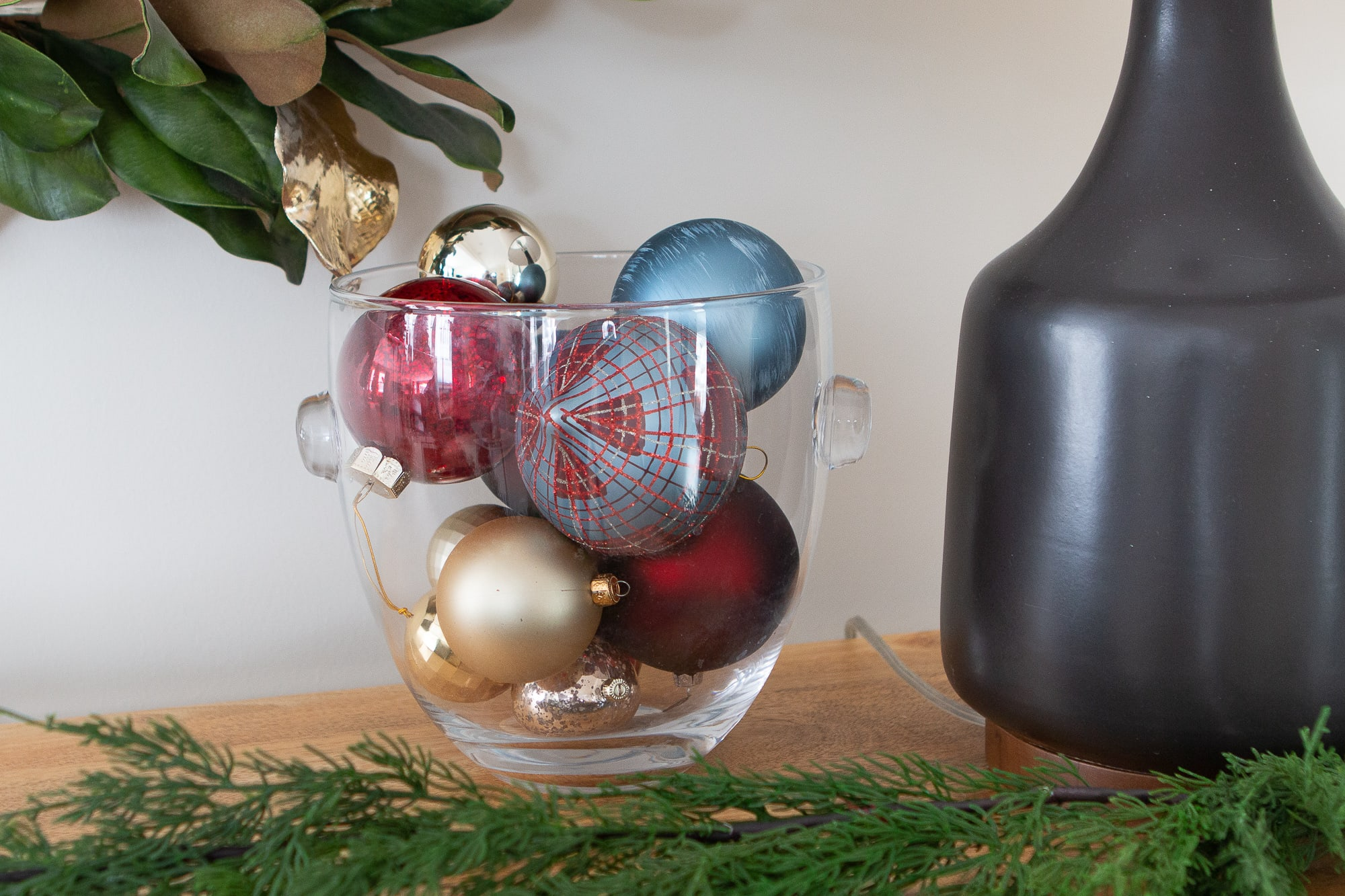 Fill a bowl with ornaments in your holiday entry