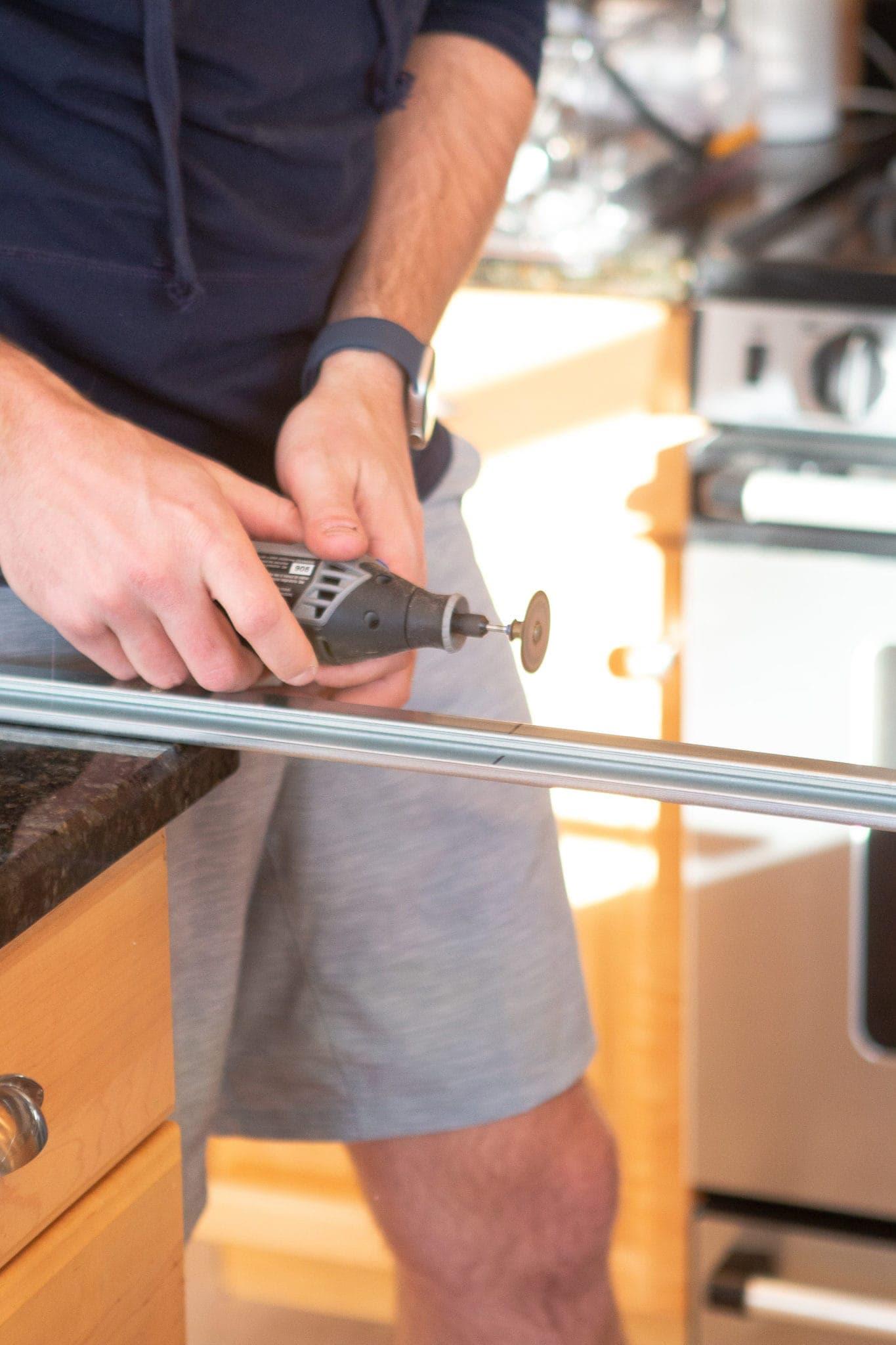 Using a metal dremel bit to cut metal rail on IKEA