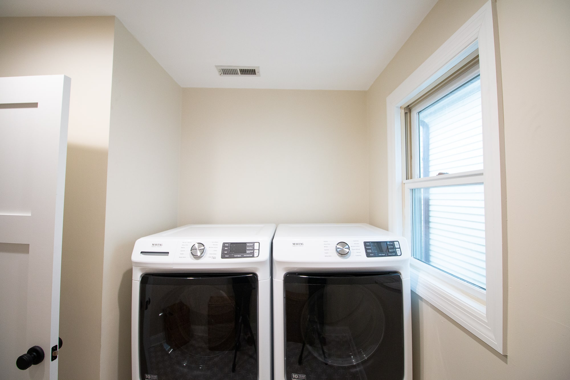 Over the washer and dryer