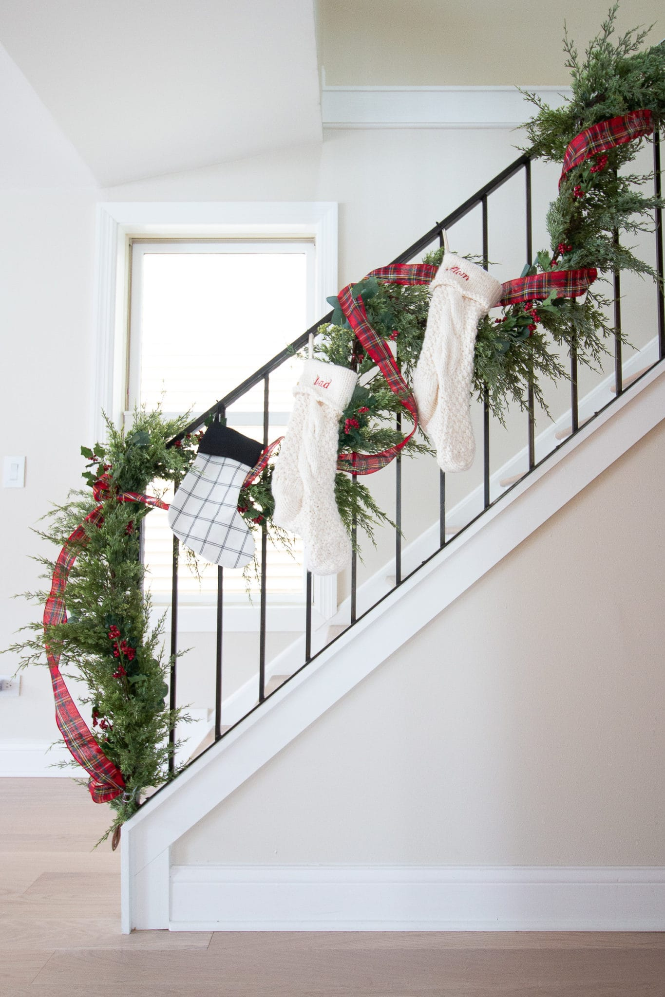 Adding faux garland to a banister