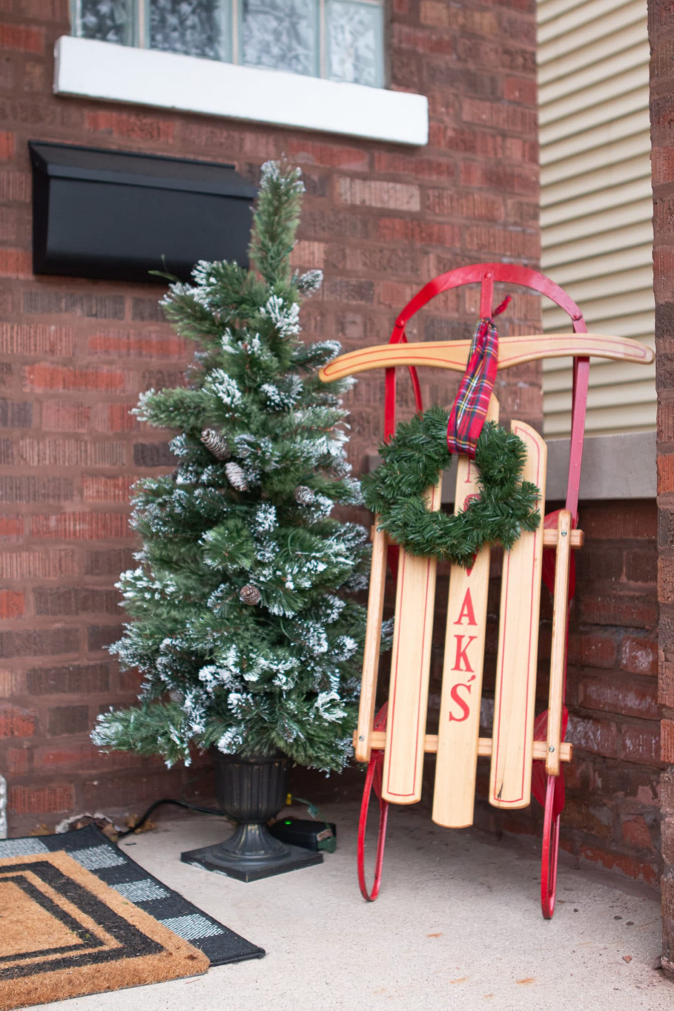 Sleigh and tree on the front porch for my 2019 christmas home tour