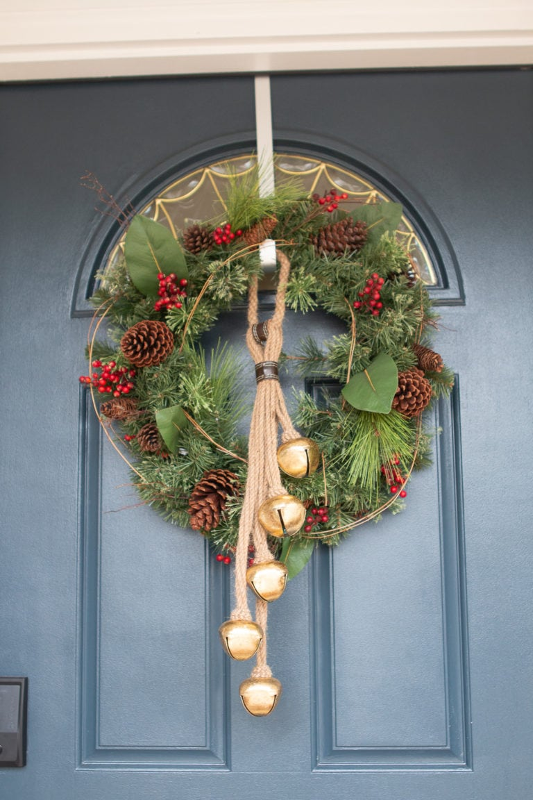 Front door with wreath and bells