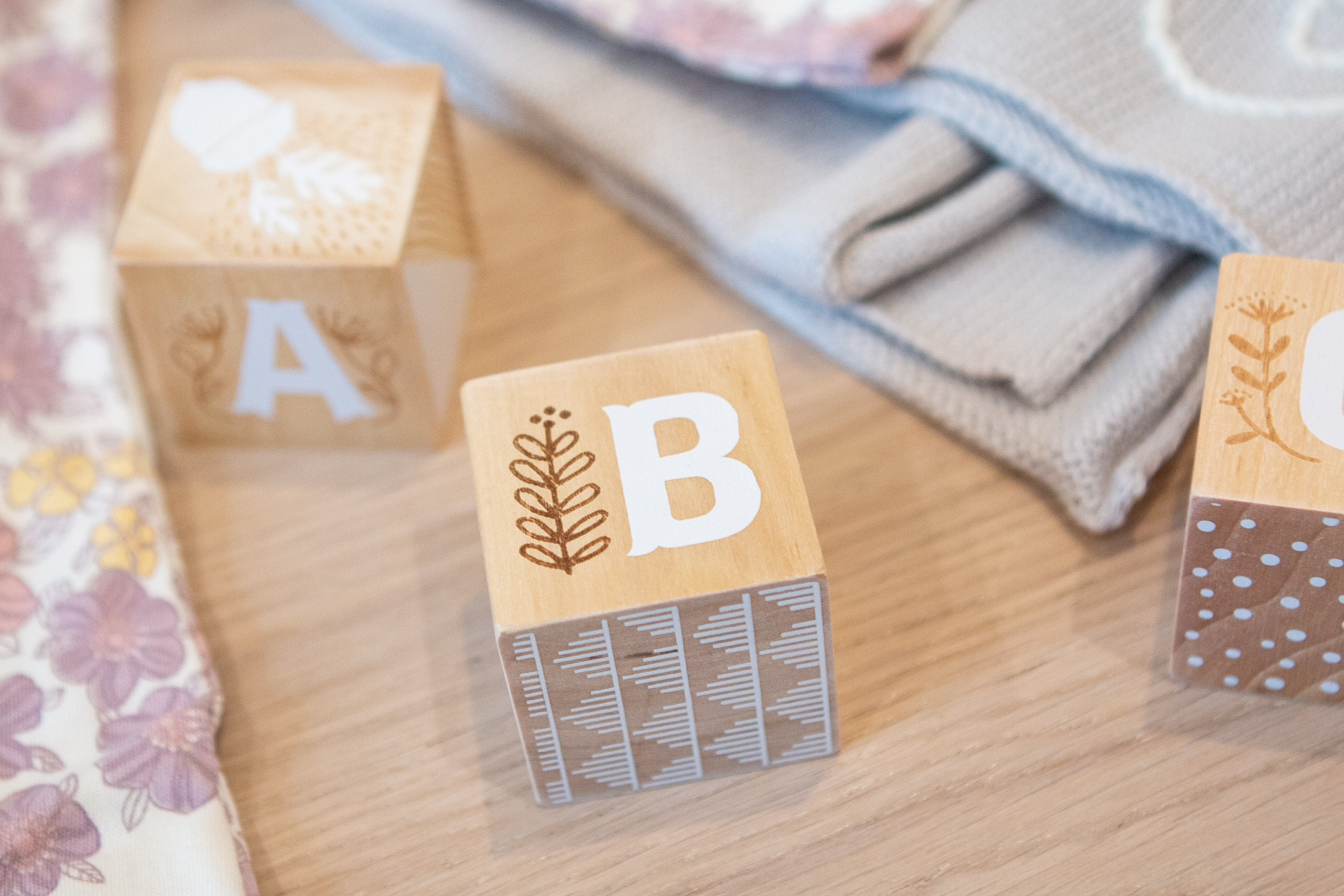 Baby registry tips add cute etched blocks for nursery decor