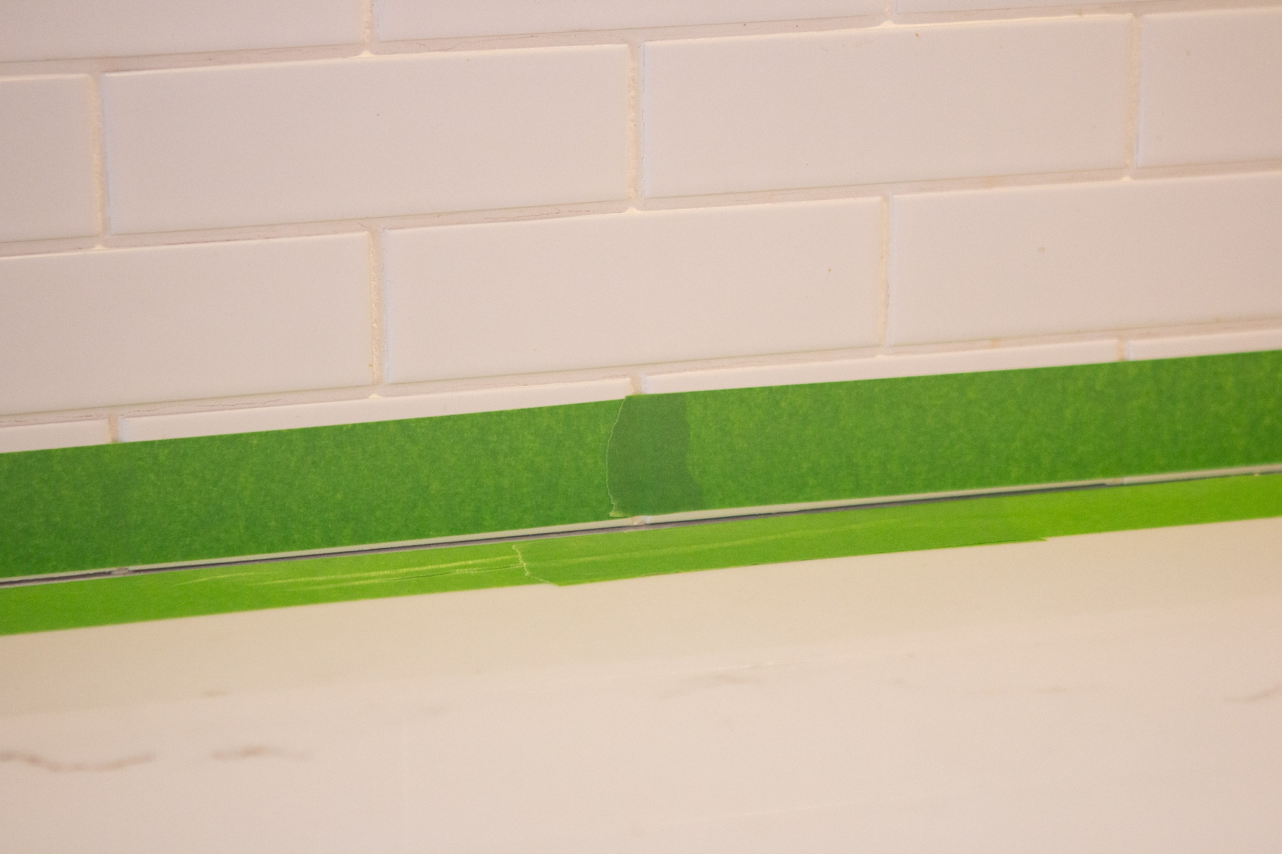 Use painter's tape when caulking a backsplash