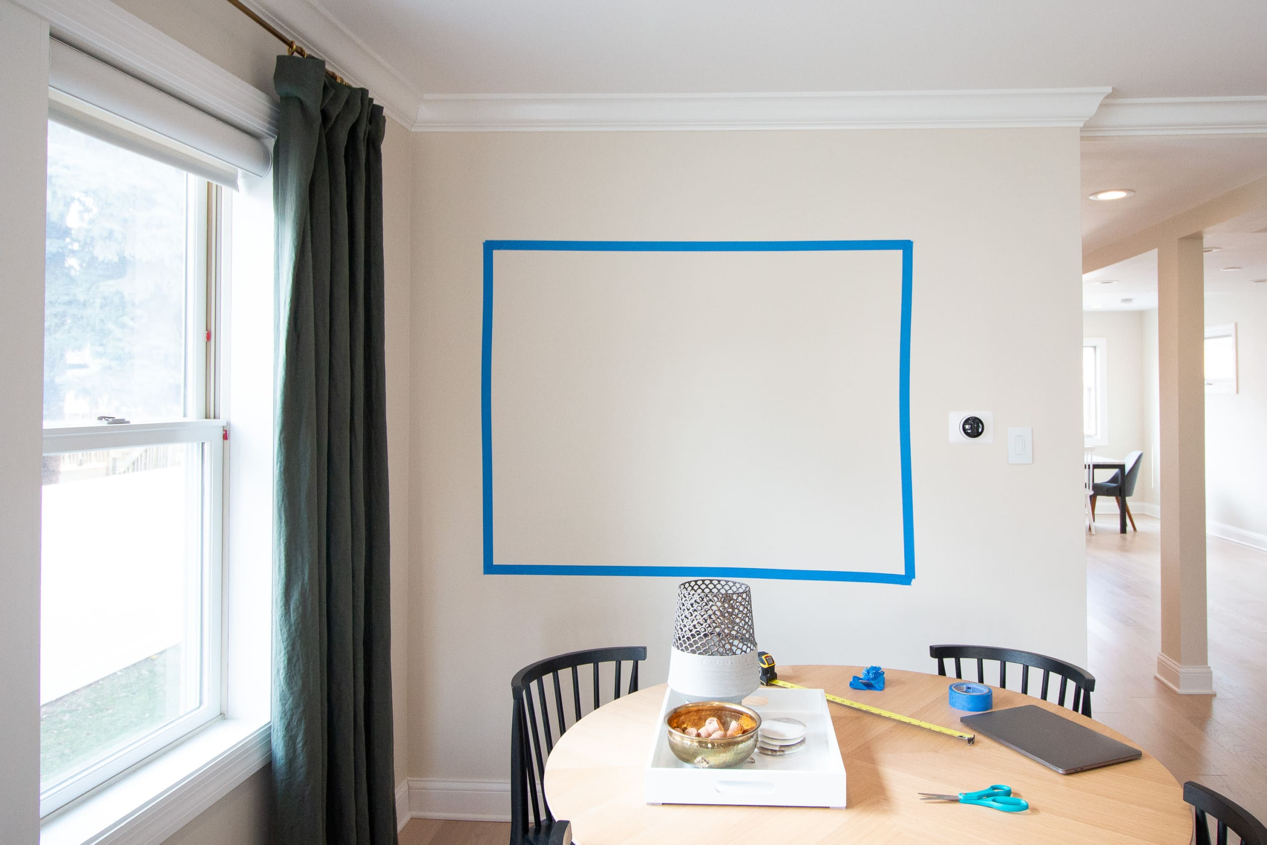 Tape out the wall when hanging a living room gallery wall
