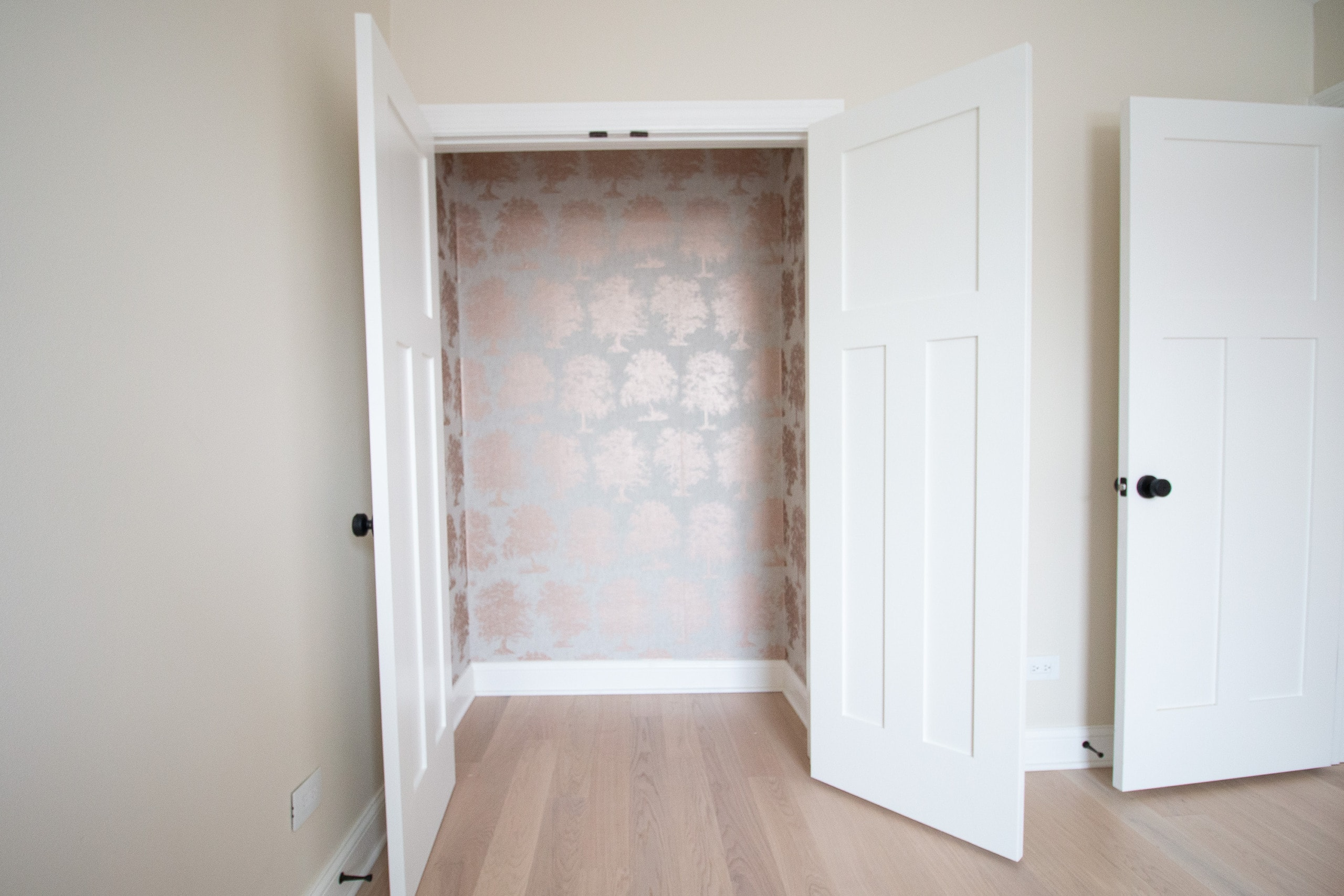 Wallpapered closet after