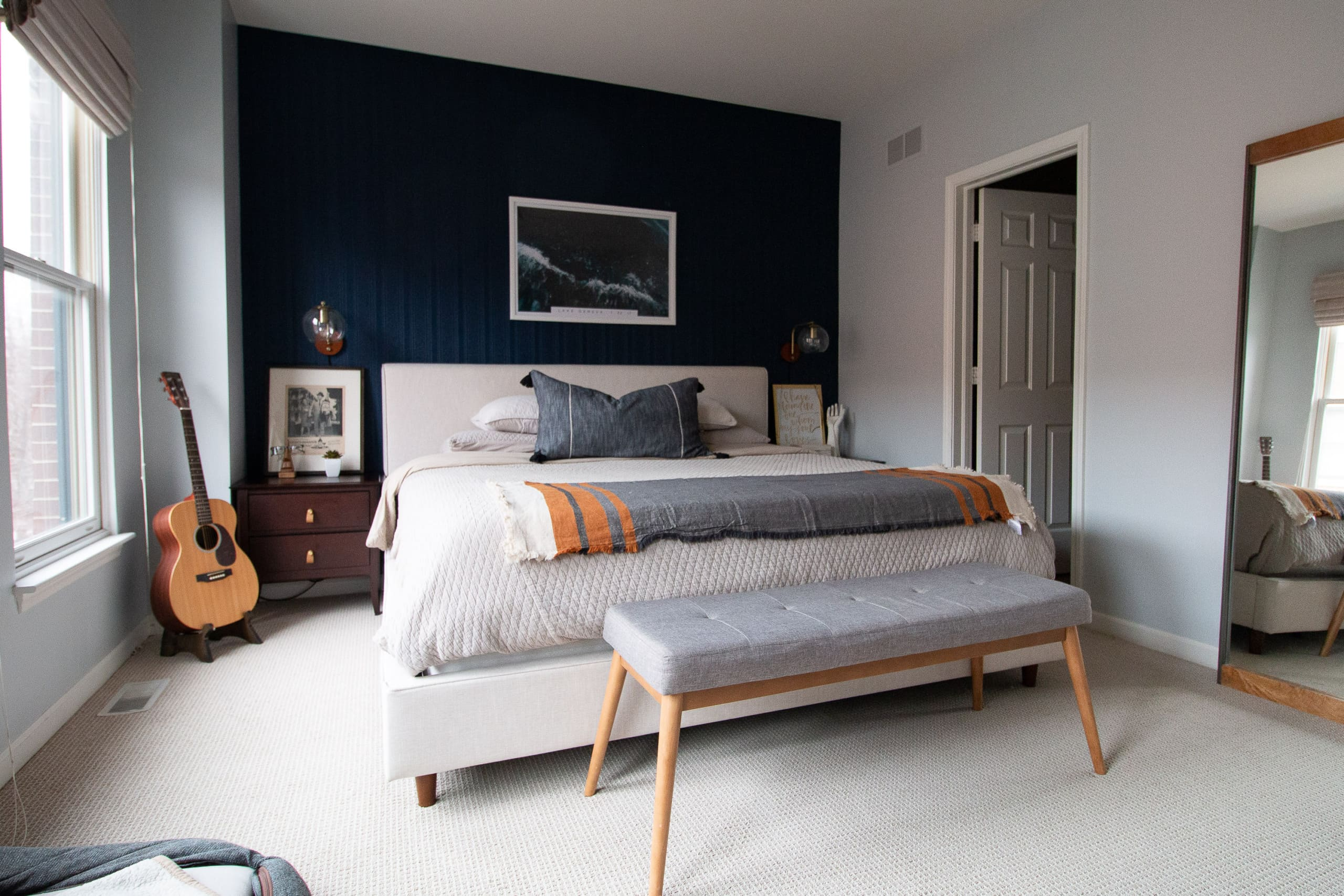 Master bedroom with navy accent wall
