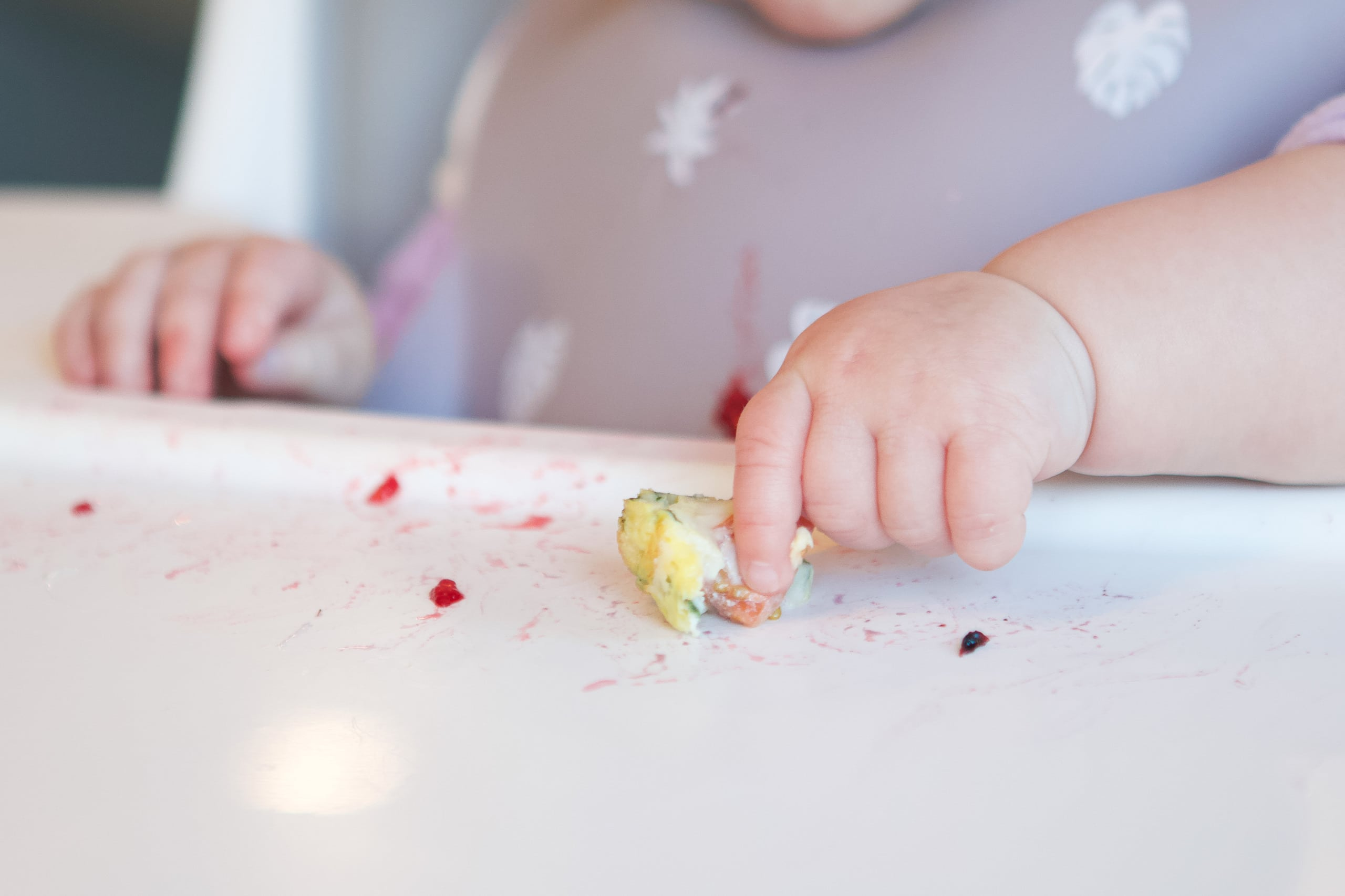 Rory doing baby led weaning and using her pincer grasp