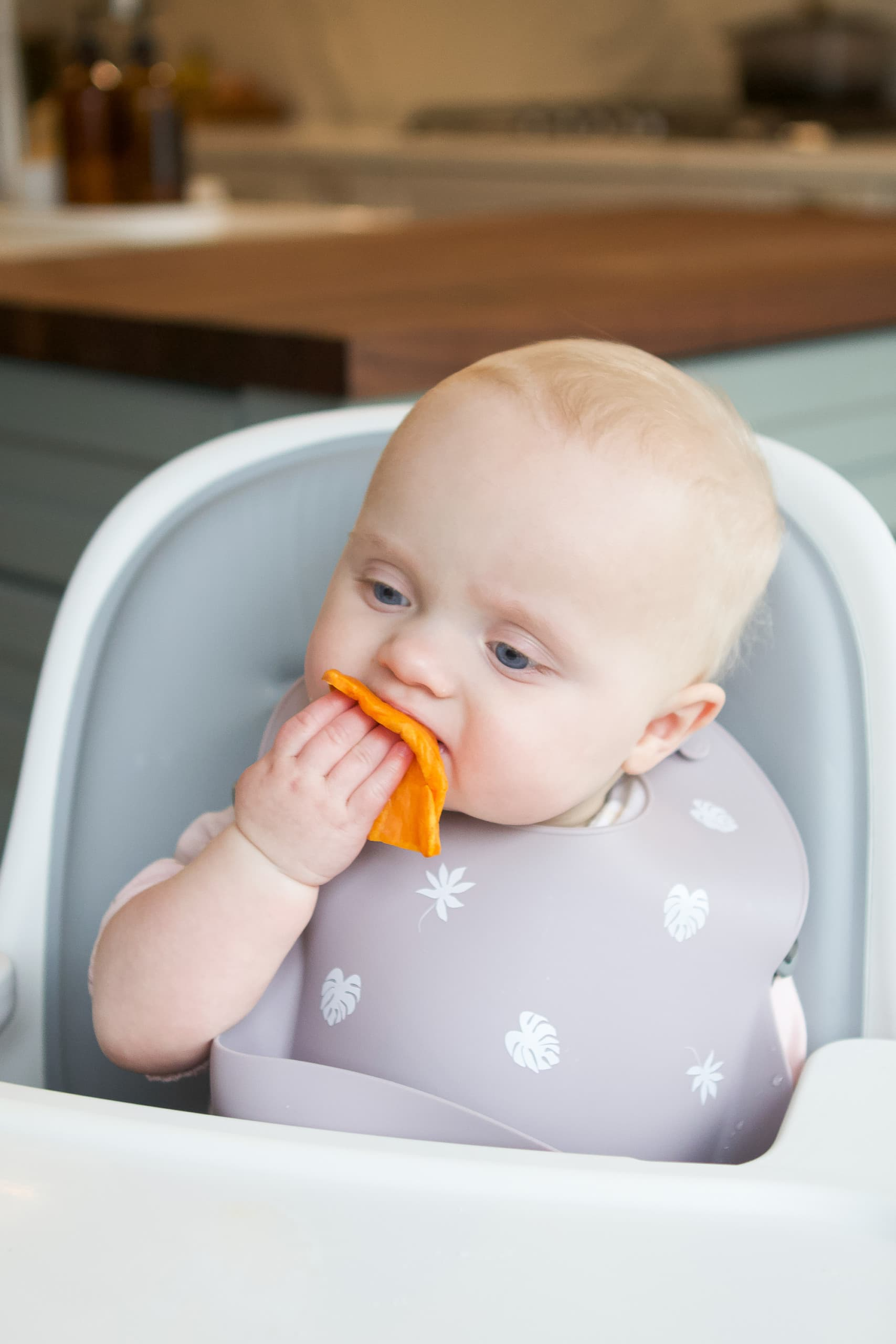 Rory doing baby led weaning to eat sweet potatoes