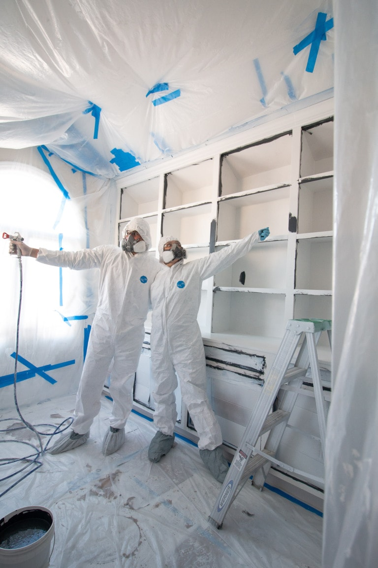Wearing a paint suit for spraying