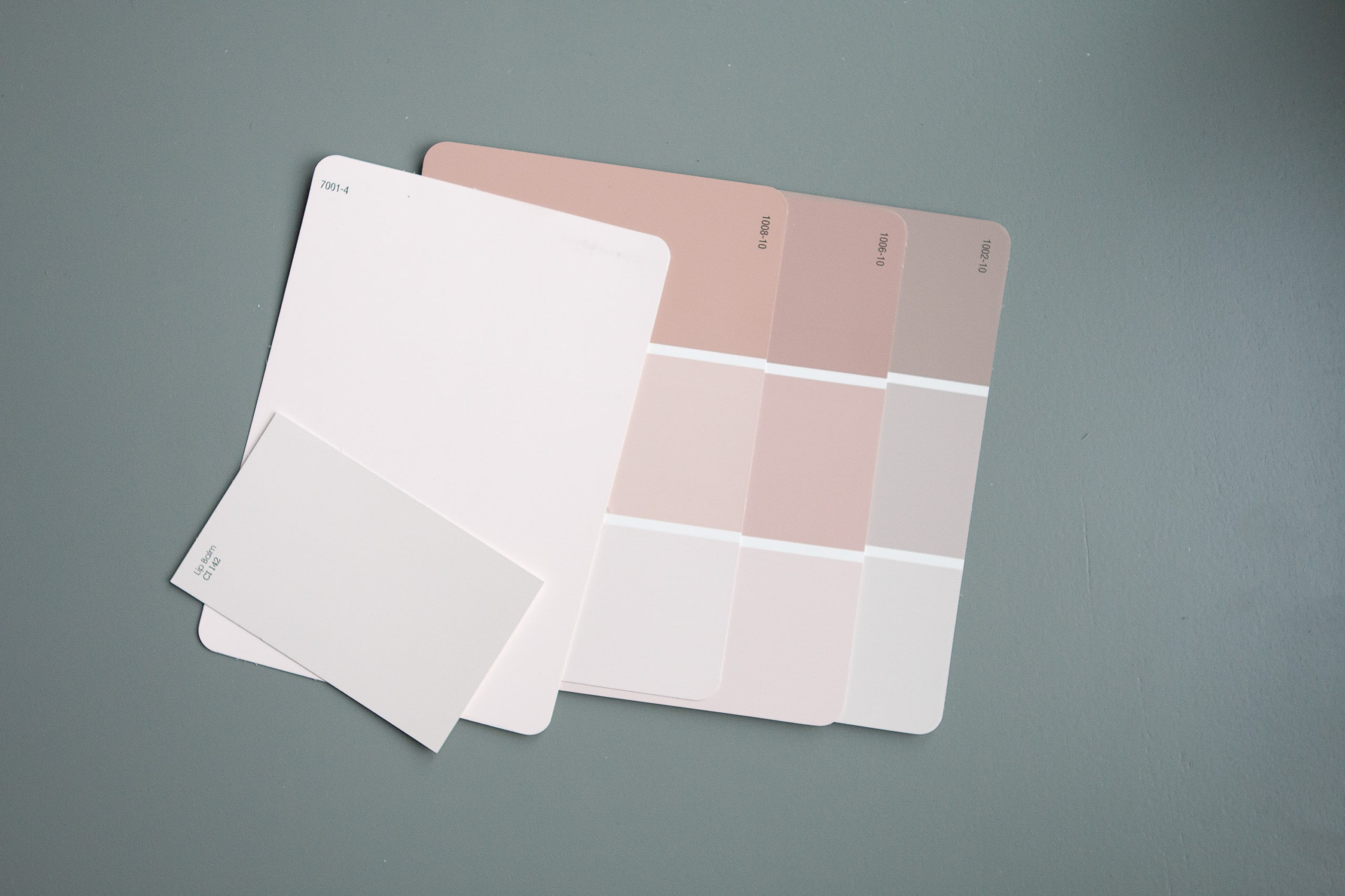 Looking at paint swatches to choose a paint color