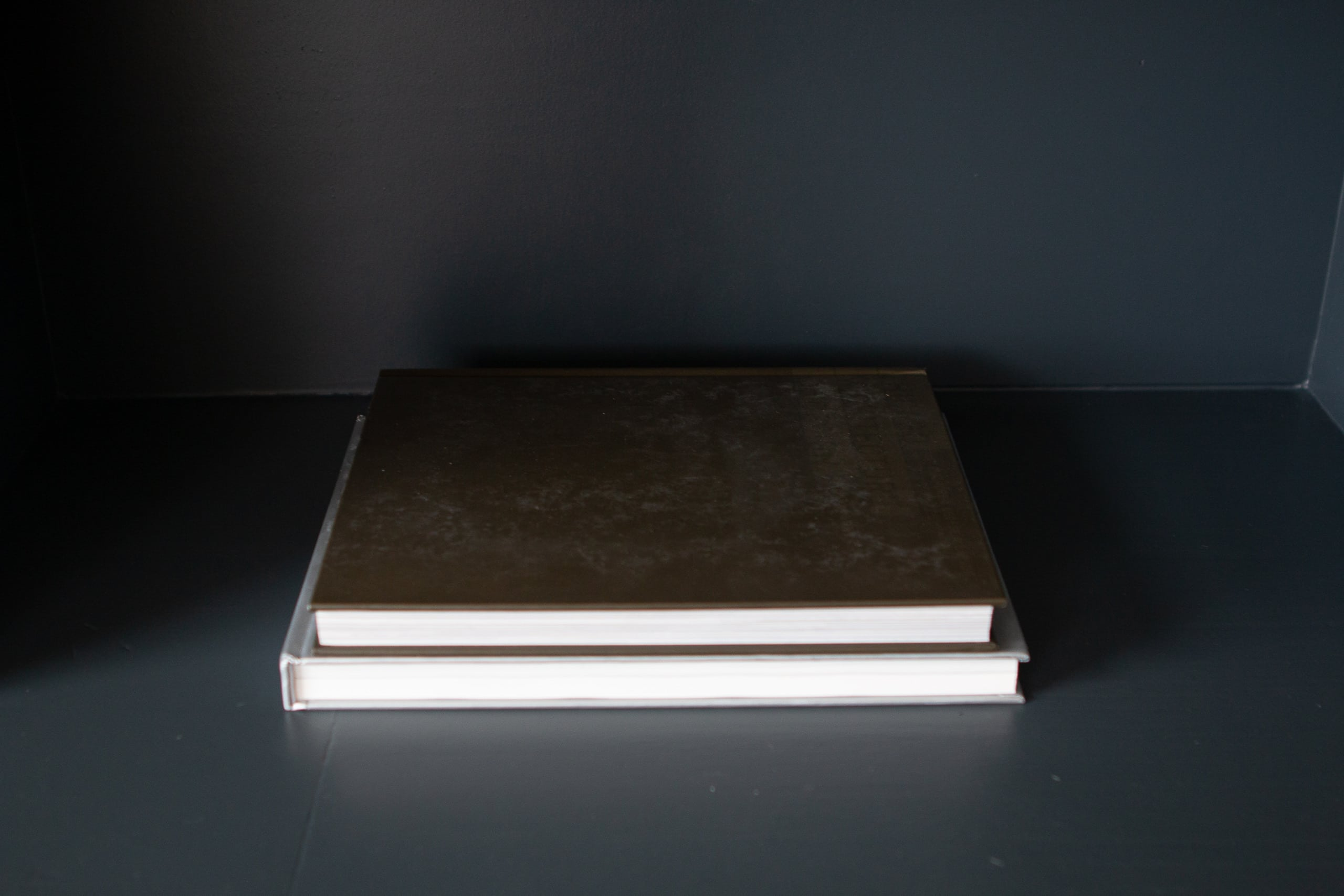 Use coffee table books to ground surfaces
