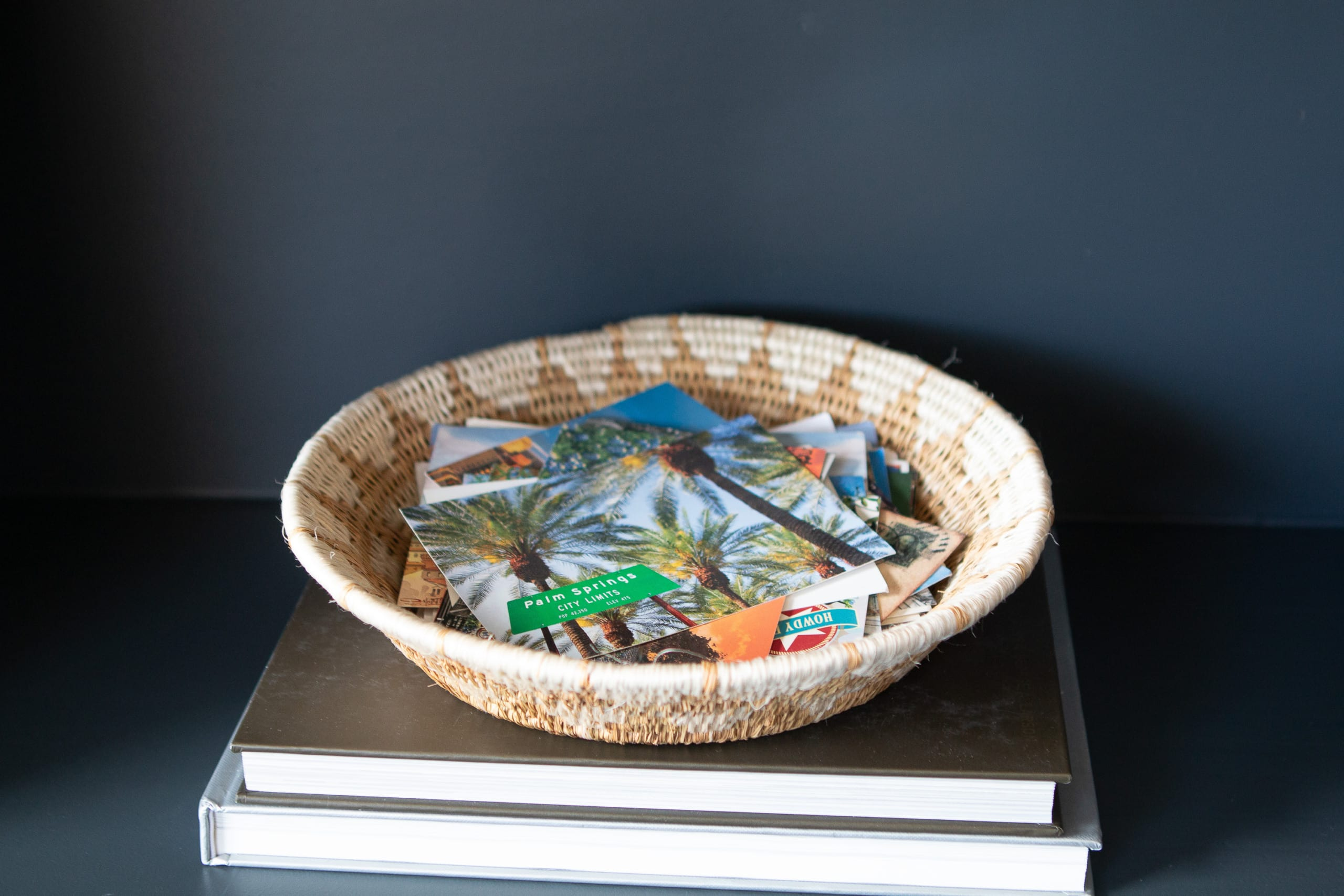 Add a basket of postcards to your shelf