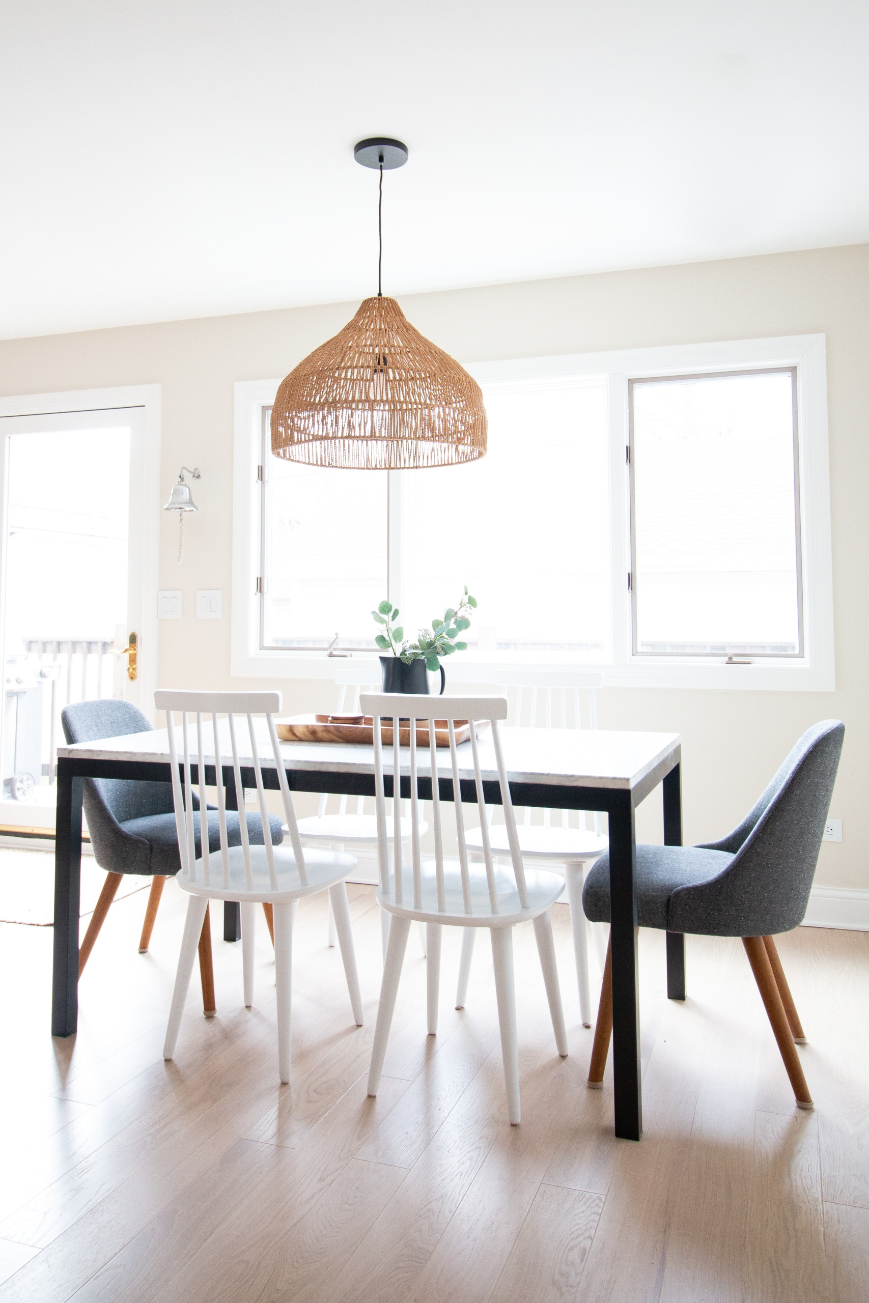 Dining room with woven light fixture