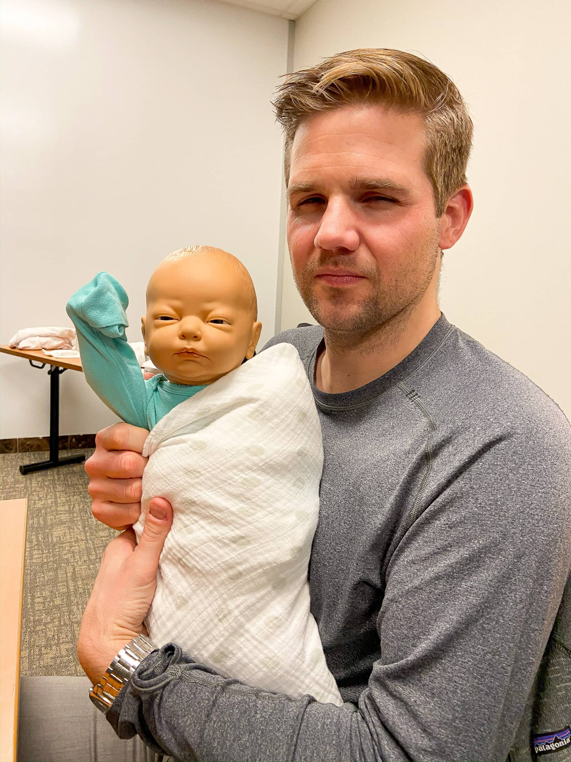 finn and doll in newborn class