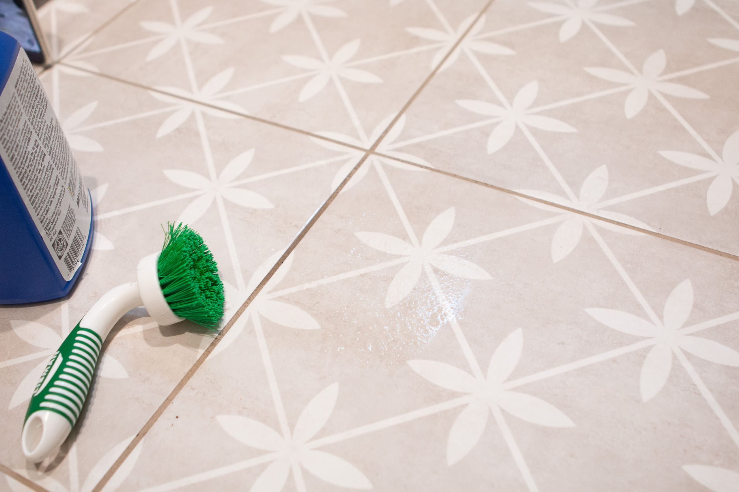 Use a brush to agitate the cleaning solution