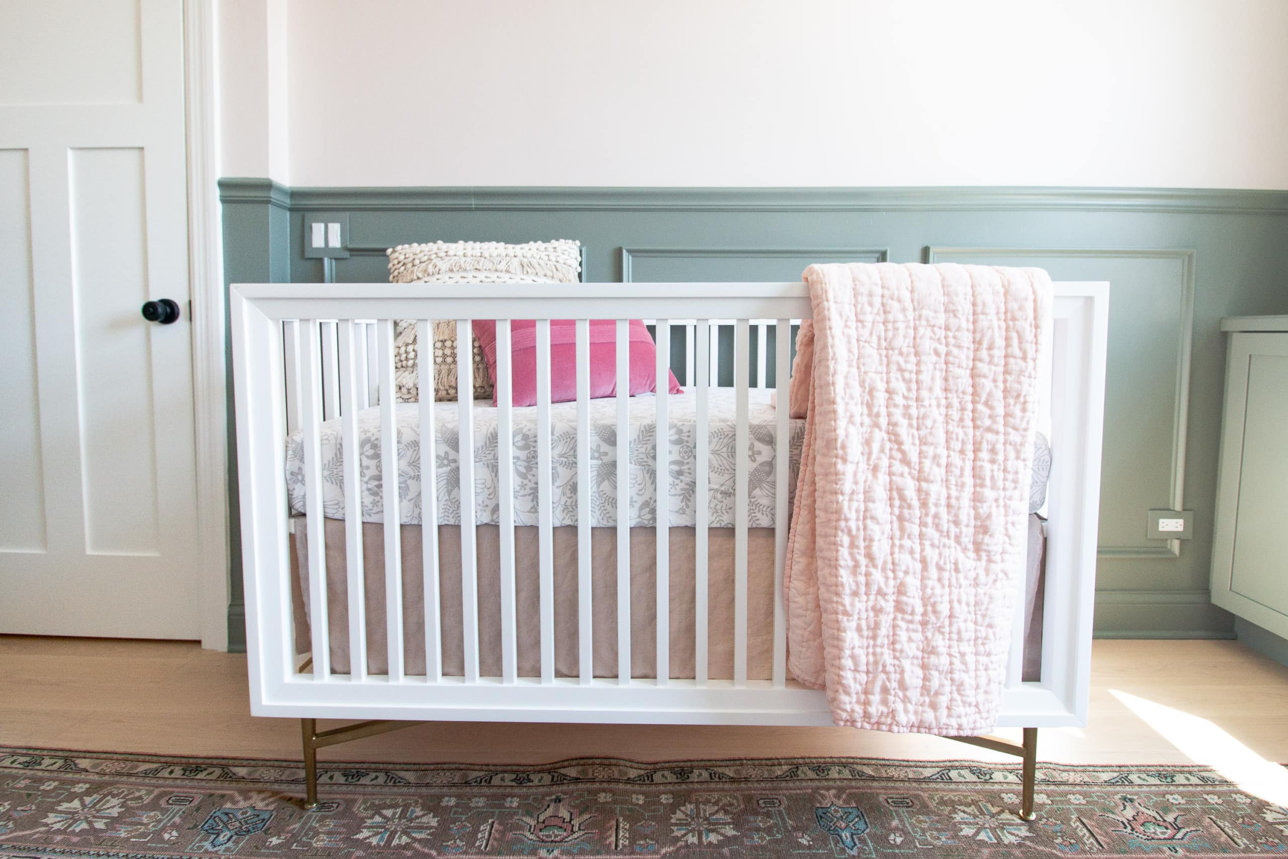 White and brass crib from Crate and Kids