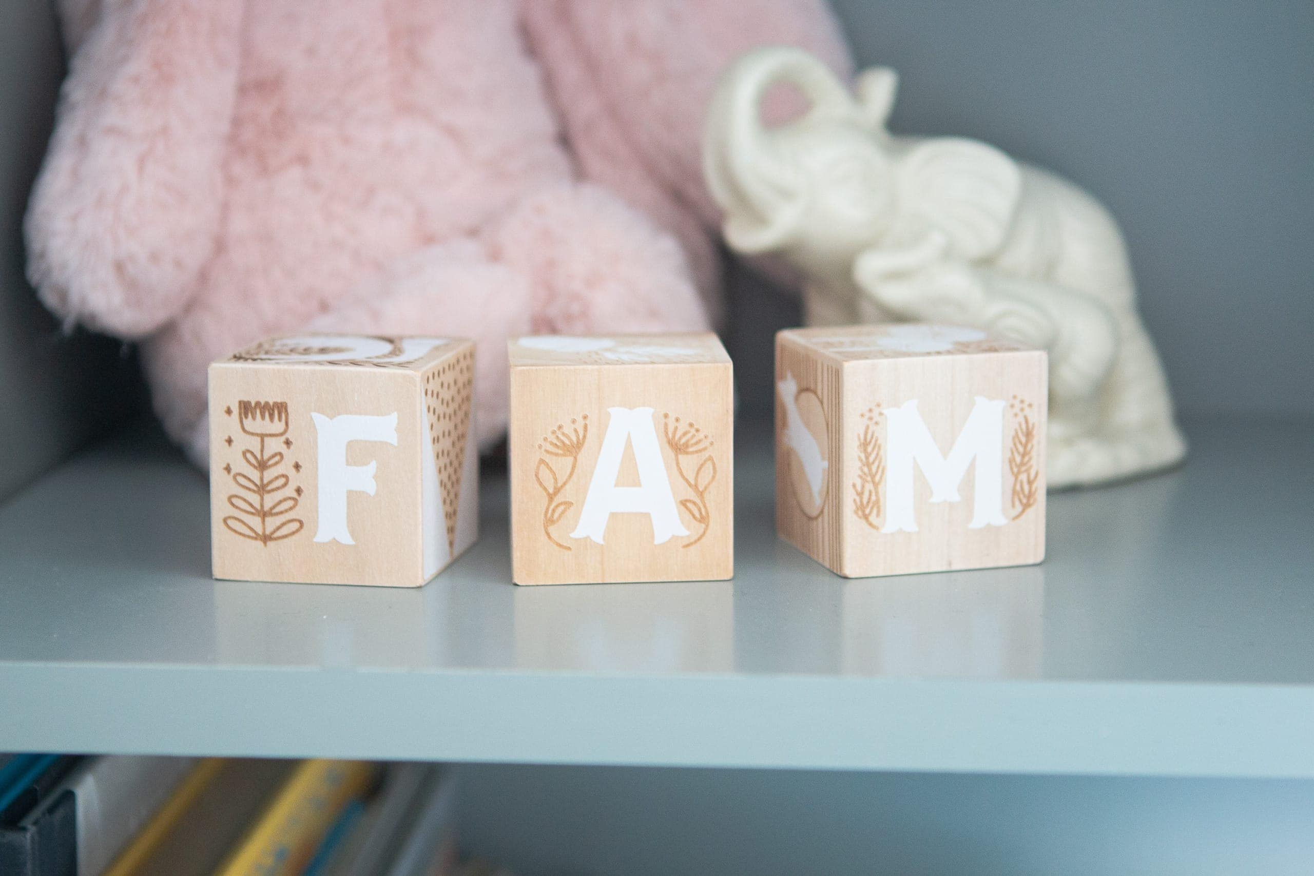 Wooden blocks as decor in a baby girl's nursery