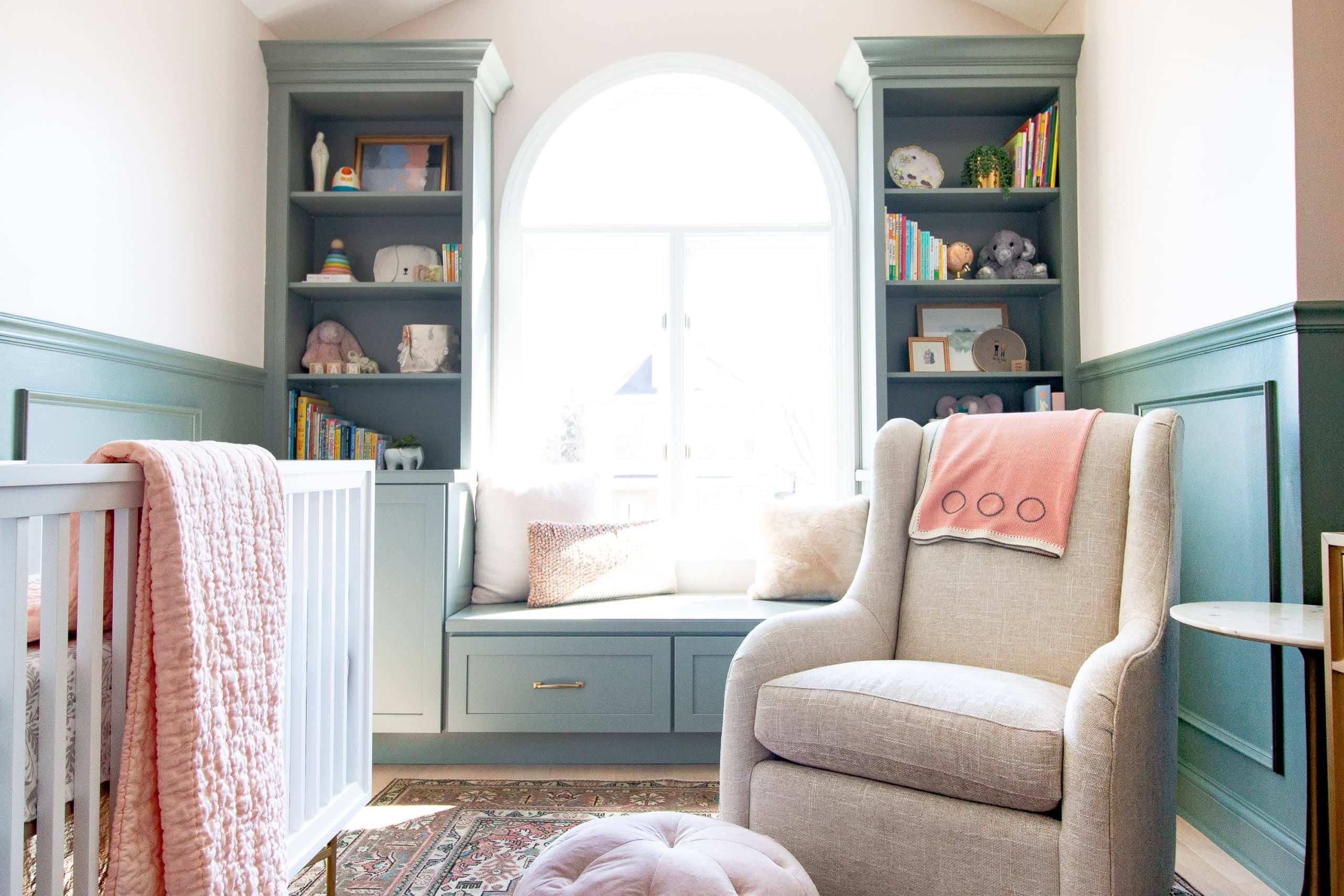 Sage green built-is in a baby girl's nursery