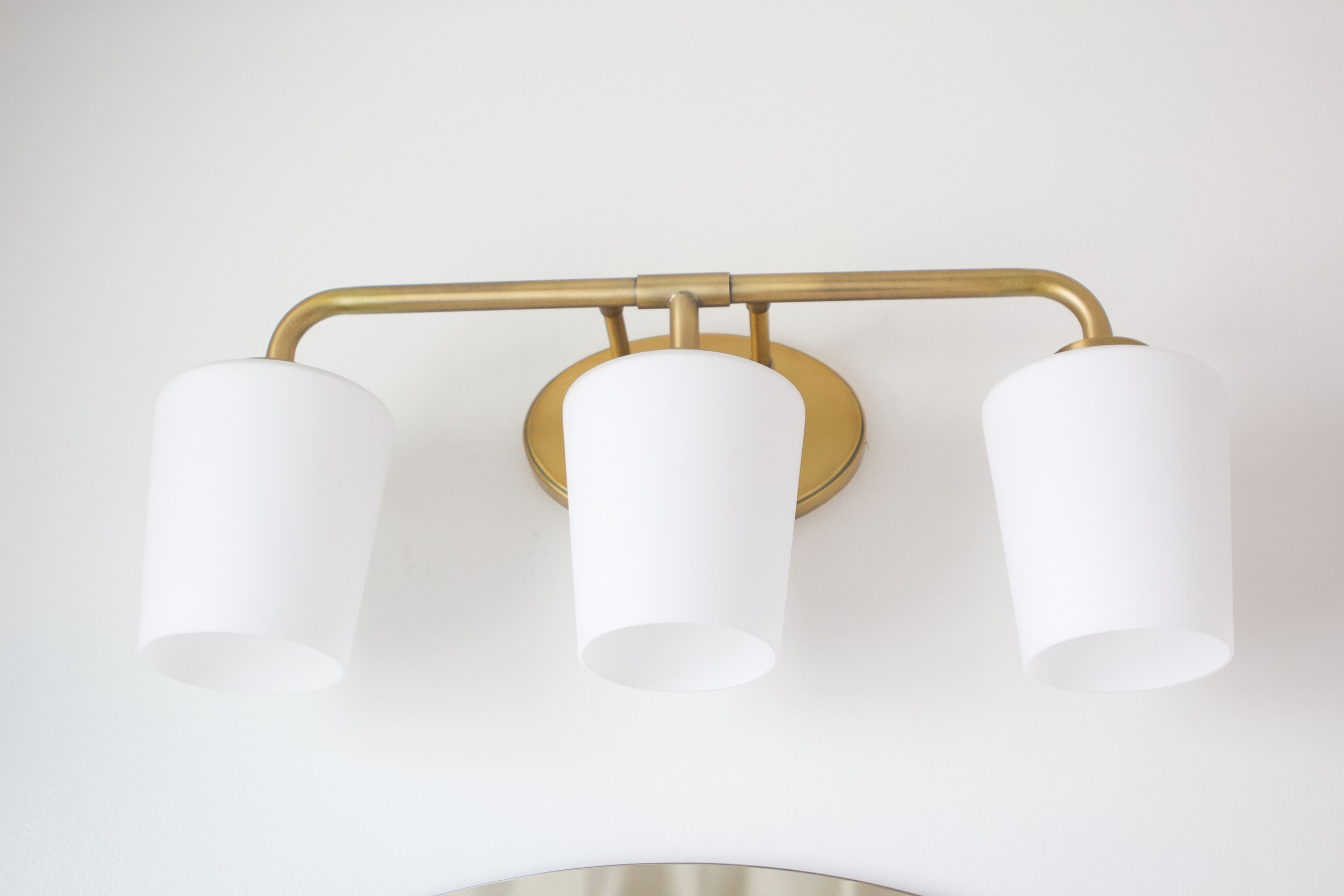 Brass vanity light fixture