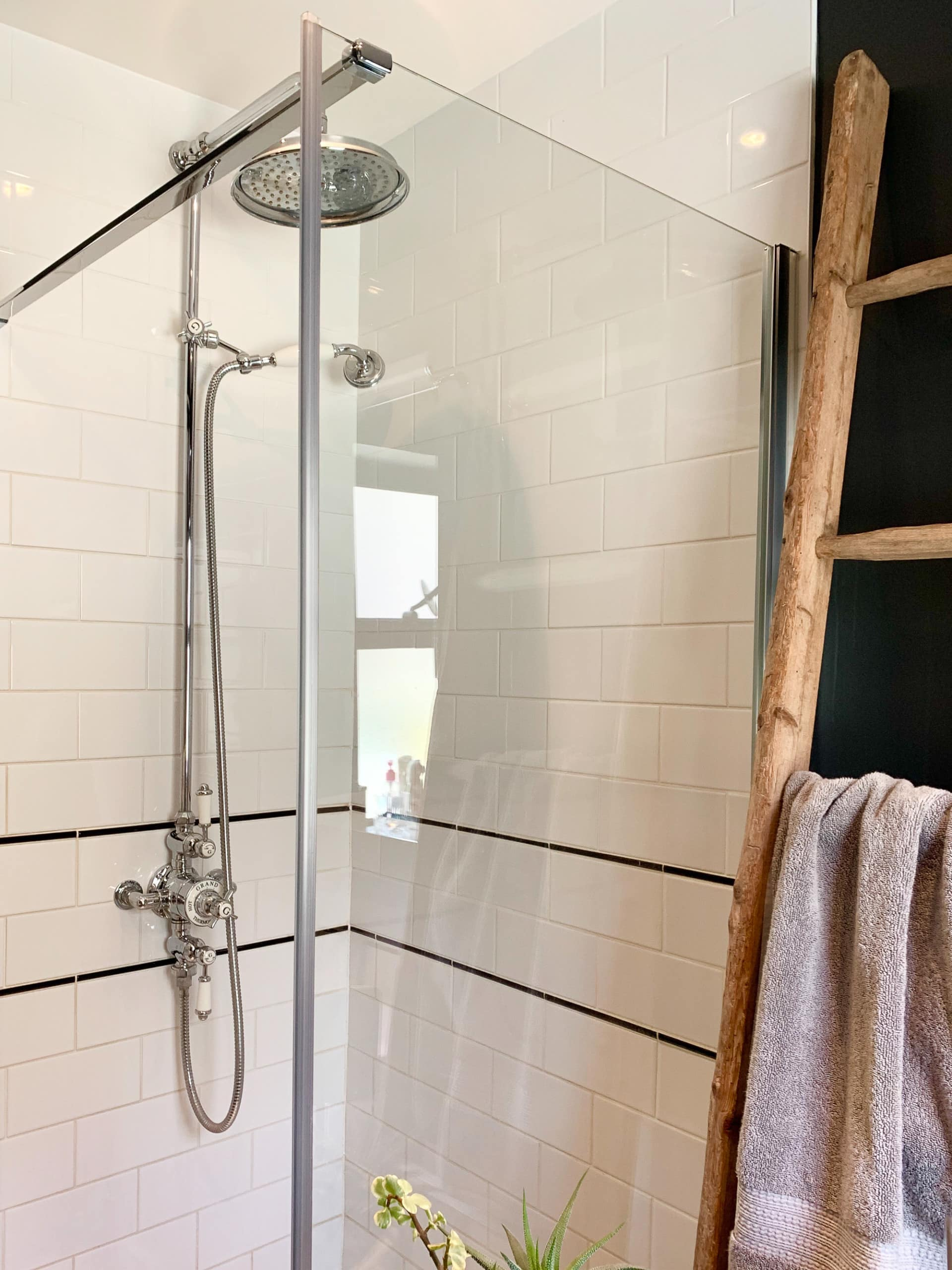 Tiled shower in a bathroom