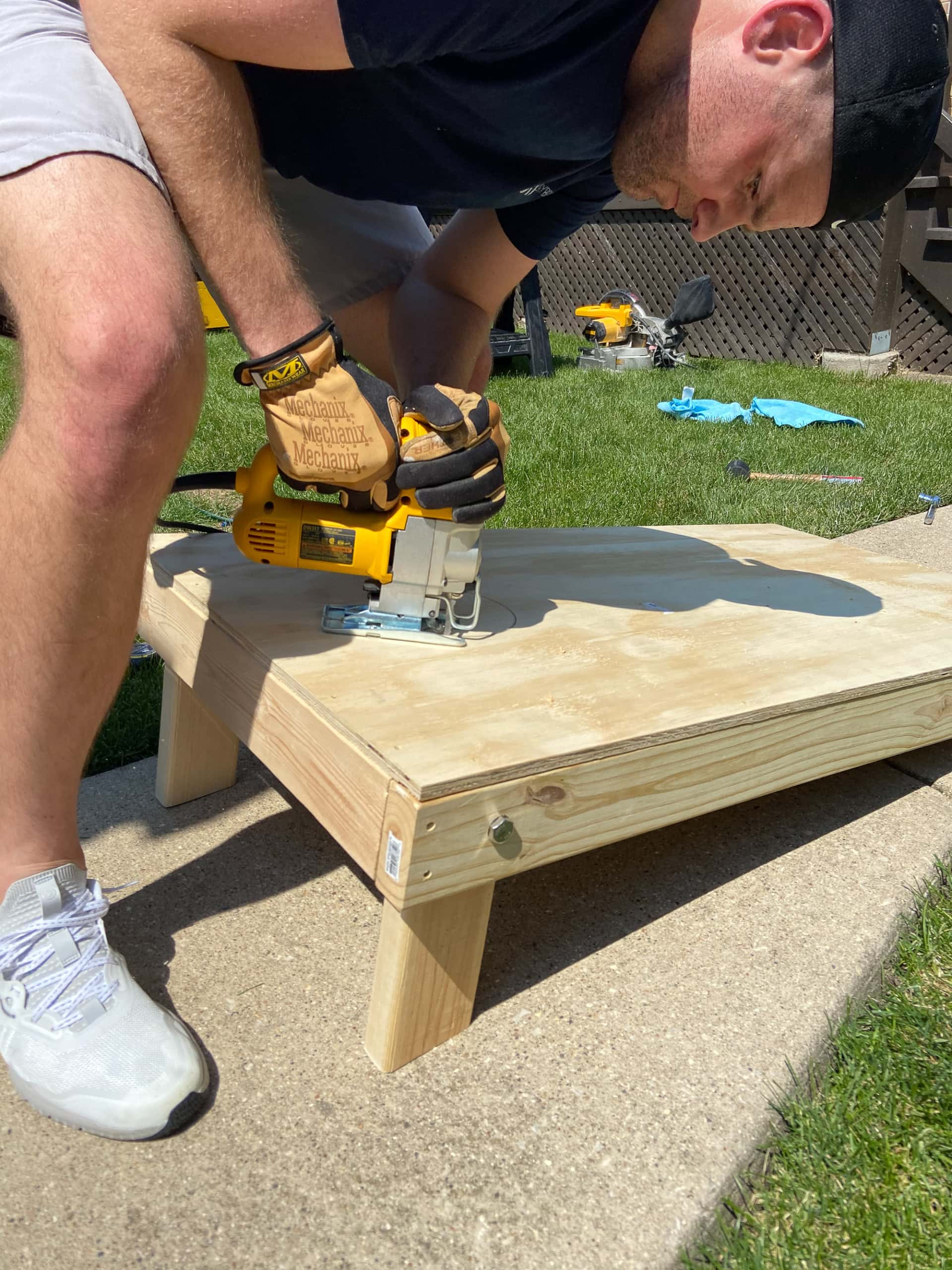 use a jigsaw to cut the cornhole hole