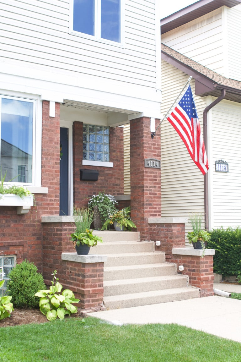 How to install a flag pole into brick