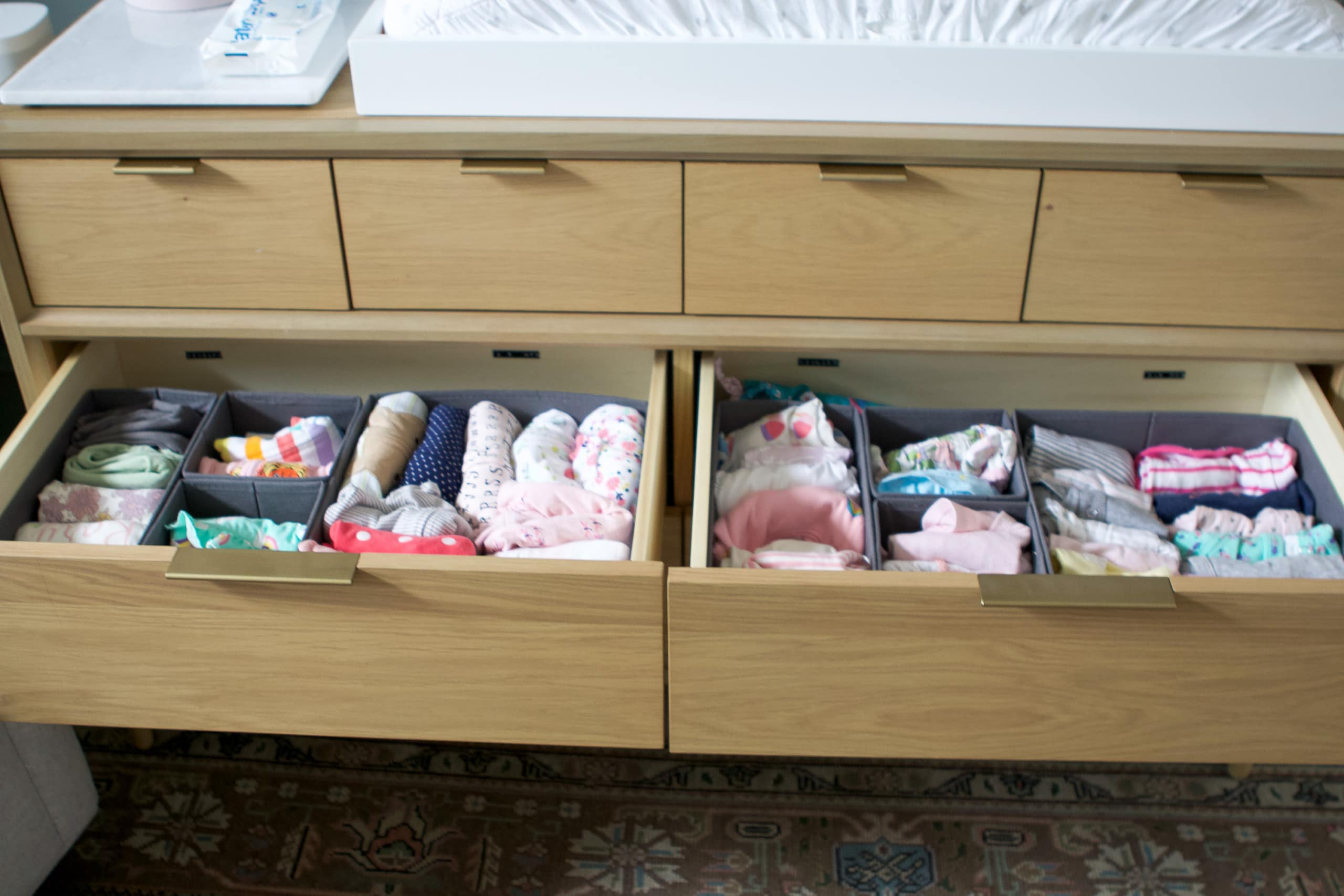 How to organize a nursery dresser