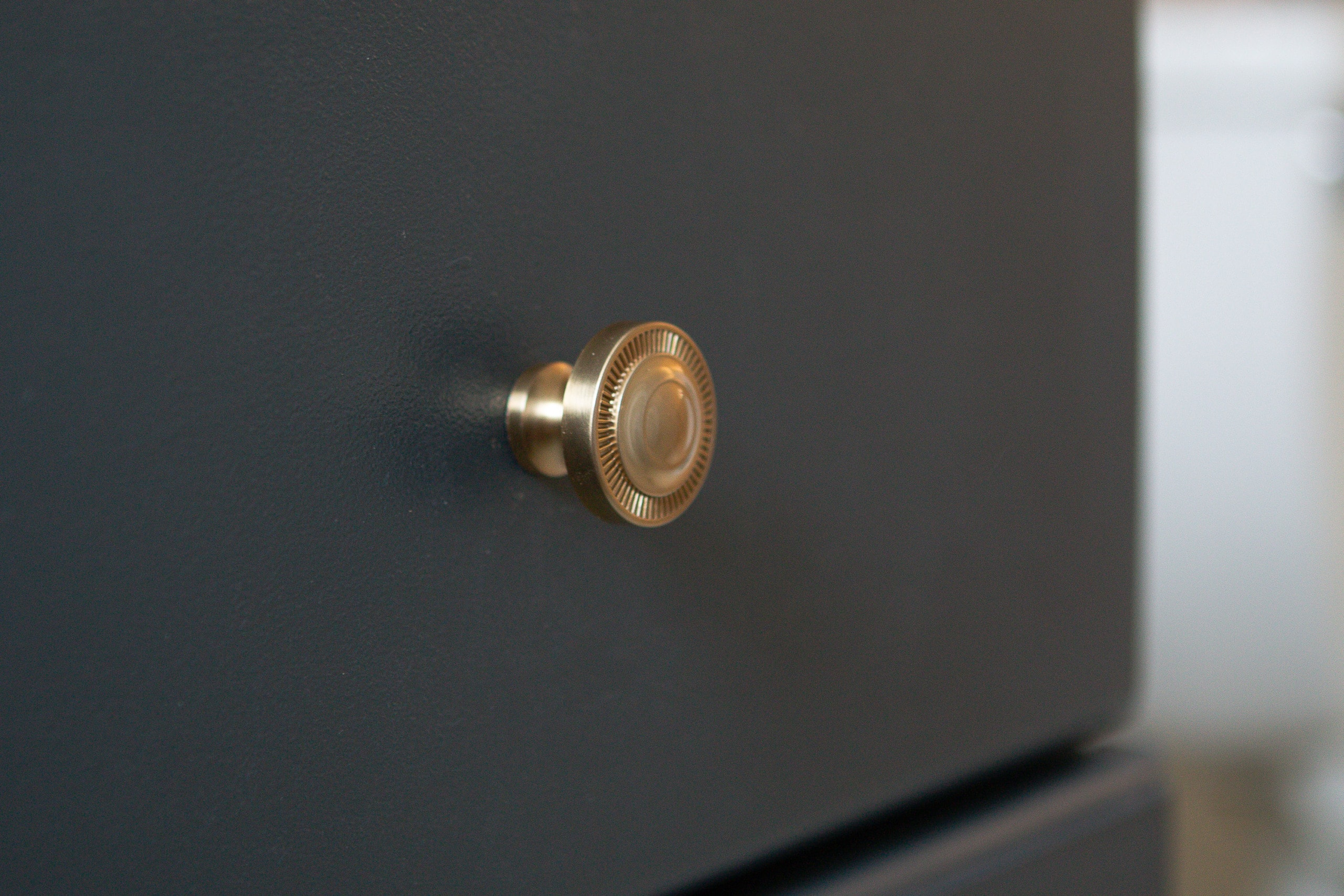 Gold hardware on navy cabinets