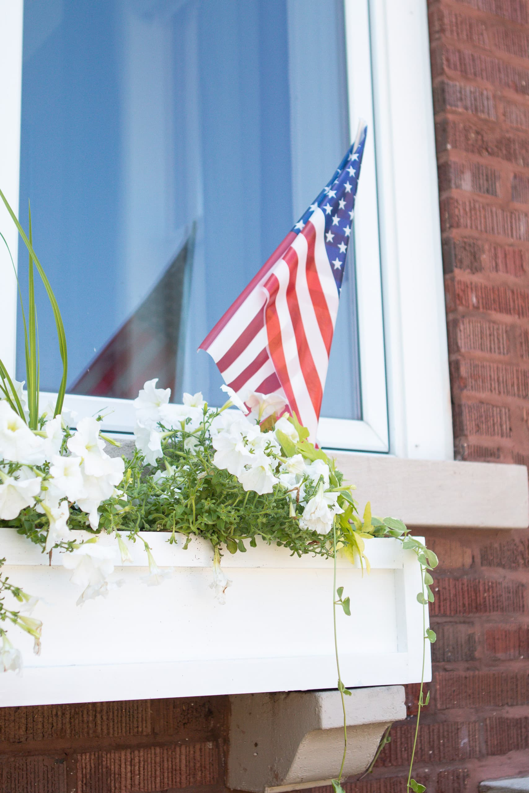 American flag in a window box