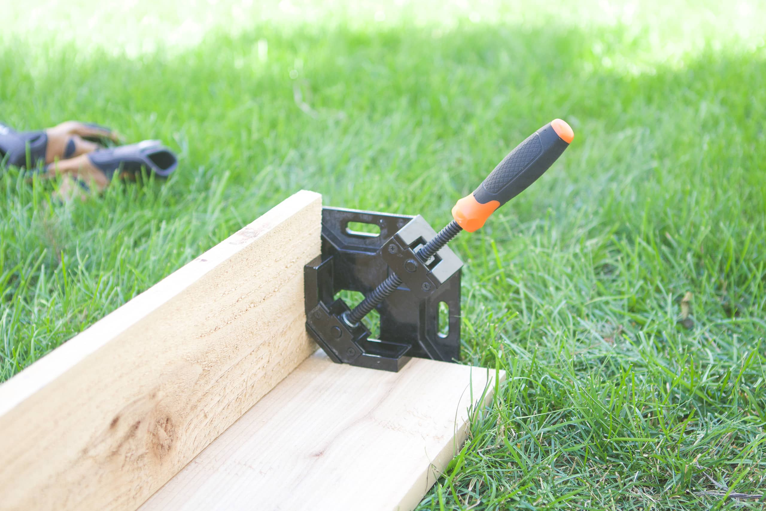 Using a corner clamp to hold two pieces of wood together